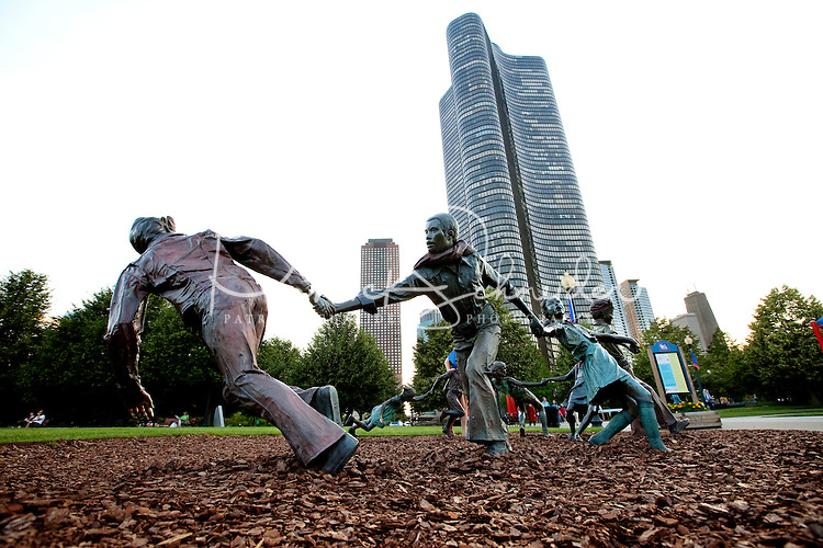 A string of iron children play in a park near downtown Chicago, Ill.