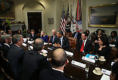 United States President Barack Obama (3R) and Vice President Joe Biden meet with executives from leading technology companies, including Apple, Twitter, and Google in the Roosevelt Room of the White House on December 17, 2913 in Washington, DC. The White House said the meeting focused on efforts to repair administration's troubled HealthCare.gov website. <br /> Credit: Mark Wilson / Pool via CNP