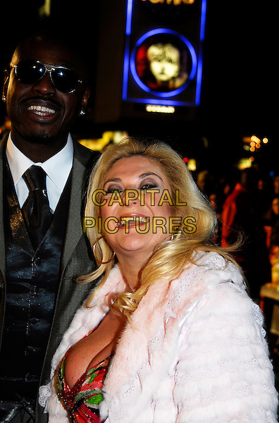 "BEN OFOEDU & VANESSA FELTZ.""Arthur And The Invisibles"" UK film premiere at Vue Leicester Square, London, UK..January 25th, 2007.half length white fur coat sunglasses shades couple.CAP/IA.©Ian Allis/Capital Pictures"