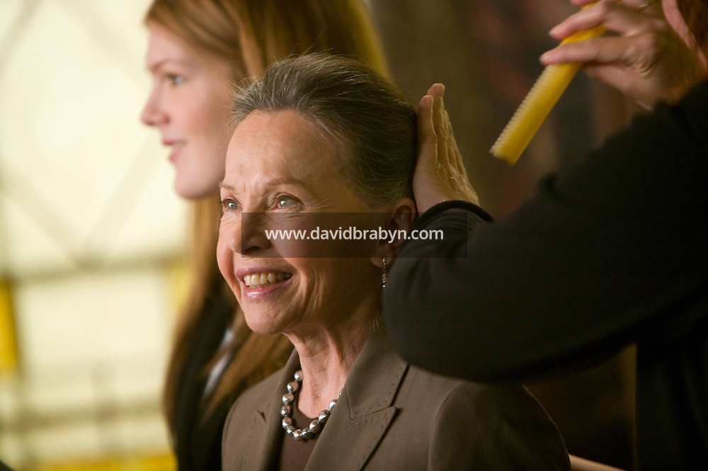 """8 May 2006 - North Bergen, NJ - French actress Leslie Caron (C) get her hair retouched on the studio set of television show """"Law & Order: SVU"""" in North Bergen, USA, 8 May 2006. In this rare appearance in front of American television cameras, Caron, 74, plays a French victim of past sexual molestation in an episode entitled """"Recall"""" due to air in the fall. Caron starred in Hollywood classics such as """"An American in Paris"""" (1951), """"Lili"""" (1953), """"Gigi"""" (1958). More recently she appeared in """"Chocolat"""" (2000) and """"Le Divorce"""" (2003). Photo Credit: David Brabyn"""