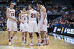 Wisconsin Badgers teammates huddle during the fourth-round game in the NCAA college basketball tournament against the Baylor Bears Thursday, March 27, 2014 in Anaheim, California. The Badgers won 69-52. (Photo by David Stluka)
