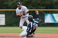 23 October 2010: Aaron Hornostaj of Rouen throws the ball to first base over Tim Stewart for a double play during Savigny 8-7 win (in 12 innings) over Rouen, during game 3 of the French championship finals, in Rouen, France.