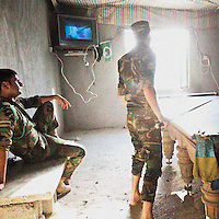 HAWEEYA, DIYALA PROVINCE, KURDISTAN.<br /> Kurdish Army officers play pool to relax. The Haweeya forward operating base houses a combination of Kurdish army and special forces, who are currently battling ISIS militants for control of Jalowla, a city in Diyala Province, 25km down the road.