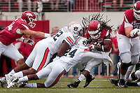 NWA Democrat-Gazette/BEN GOFF @NWABENGOFF<br /> Gimel President (42) and Blake Countess (24), Auburn defenders, tackle Alex Collins, Arkansas running back, in the first quarter on Saturday Oct. 24, 2014 during the game in Razorback Stadium in Fayetteville.