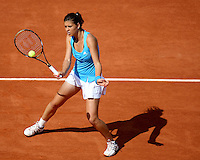 Sorana Cirstea (ROU) against Jelena Jankovic (SRB) (5) in the fourth round of the Women's Singles. Cirstea beat Jankovic 3-6 6-0 9-7..Tennis - French Open - Day 9 - Mon1st June 2009 - Roland Garros - Paris - France..Frey Images, Barry House, 20-22 Worple Road, London, SW19 4DH.Tel - +44 20 8947 0100.Cell - +44 7843 383 012
