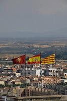 Flags flapping over the roof tops of Lleida, Cataluna, Spain.