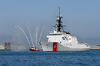 The United States Coast Guard Cutter Bertholf is escorted through San Francisco Bay by a San Francisco Fireboat at the conclusion of the voyage to its new home port in Alameda, California. The Bertholf was launched on September 29, 2006 at the Ingalls Shipyard in Pascagoula, Mississippi and was christened on November 11, 2006. It is the first of the Legend class maritime security cutters to enter the Coast Guard fleet. Photographed 7/23/08