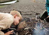 USA, Alaska, Homer, China Poot Bay, Kachemak Bay, learning to light a fire on a rock beach near the Kachemak Bay Wilderness Lodge