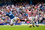 Martyn Waghorn dives in but Georgeous Sarris chears it