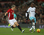 Bastian Schweinsteiger of Manchester United runs after Angelo Ogbonna Obinze of West Ham United during the English League Cup Quarter Final match at Old Trafford  Stadium, Manchester. Picture date: November 30th, 2016. Pic Simon Bellis/Sportimage
