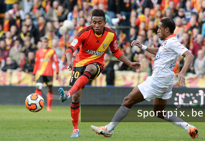 20140201 - LENS , FRANCE : RC Lens's Lalaina Nomenjanahary (l) pictured in front of Laval's Hassane Alla (r) during the soccer match between Racing Club de LENS and Stade Lavallois , on the twenty second matchday in the French Ligue 2 at the Stade Bollaert Delelis stadium , Lens . Saturday 1st February 2014. PHOTO DAVID CATRY