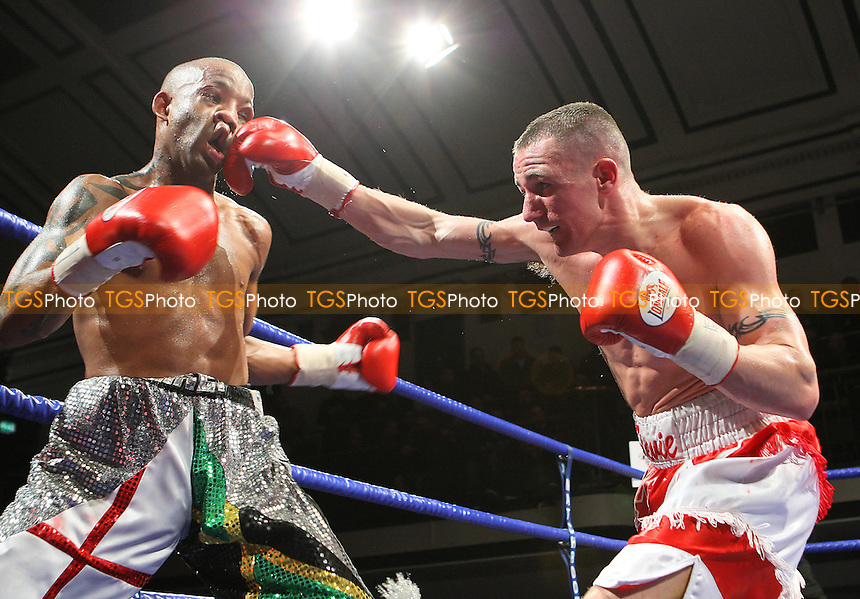 Steve Williams (red/white shorts) defeats Michael Grant in a Light-Welterweight boxing contest to win the English Title at York Hall, Bethnal Green, promoted by Barry Hearn / Matchroom Sports - 12/02/10 - MANDATORY CREDIT: Gavin Ellis/TGSPHOTO - Self billing applies where appropriate - Tel: 0845 094 6026