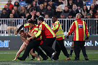 A streaker is evicted from the Rugby Championship match between the New Zealand All Blacks and South Africa Springboks at QBE Stadium in Albany, Auckland, New Zealand on Saturday, 16 September 2017. Photo: Shane Wenzlick / lintottphoto.co.nz