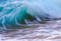 A long exposure of a large crashing wave in open ocean, creating an abstract image, North Shore, O'ahu.