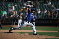 OAKLAND, CA - SEPTEMBER 8:  Chris Martin #31 of the Texas Rangers pitches against the Oakland Athletics during the game at the Oakland Coliseum on Saturday, September 8, 2018 in Oakland, California. (Photo by Brad Mangin)