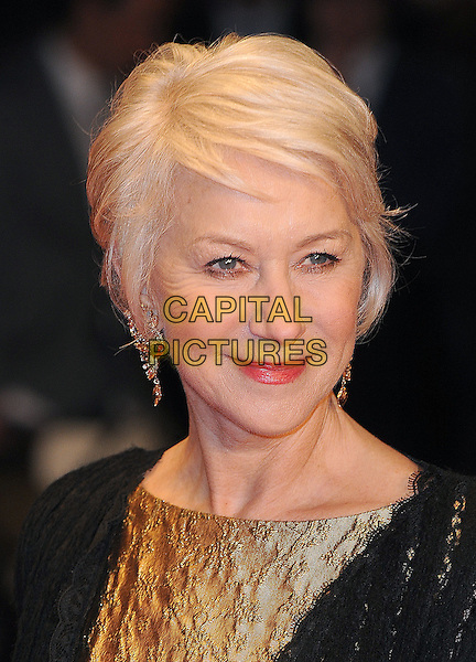 DAME HELEN MIRREN.European Premiere of 'Brighton Rock' at the Odeon West End, Leicester Square, London, England, UK,.1st February 2011..headshot portrait earrings red lipstick make-up gold black.CAP/BEL.©Tom Belcher/Capital Pictures.