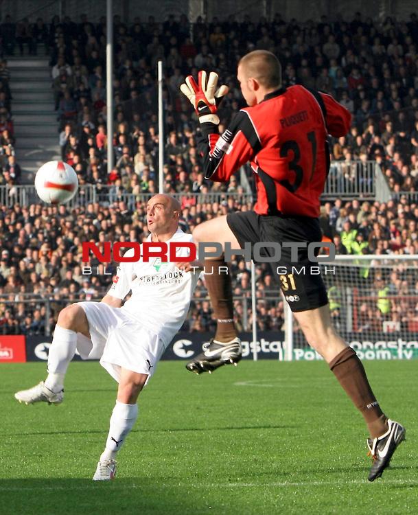 2.Liga 2007/2008  31. Spieltag Rueckrunde<br /> FC St.Pauli &ndash; vs. FC Erzgebirge Aue<br /> <br /> Skerdilaid Curri ueberlupft clever St.Pauli Benedikt Pliquett zur F&uuml;hrung 1:2 f&uuml;r FC Erzgebirge Aue.<br /> <br /> <br /> Foto &copy; nph (nordphoto)<br /> <br /> *** Local Caption ***