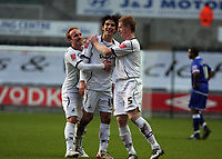 Pictured: Jordi Gomez of Swansea (C) celebrating the goal he scored from a free kick with team mate Thomas Butler (L) and Alan Tate (R)<br />