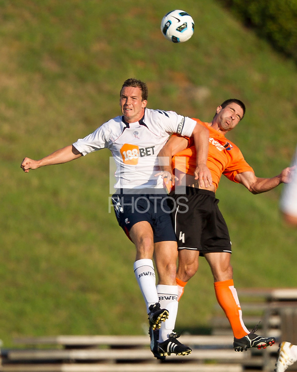 Matthew Taylor (BW) and Brady Bryant (CE) contest a header.  The Charlotte Eagles currently in 3rd place in the USL second division played a friendly against the Bolton Wanderers from the English Premier League losing 3-0.