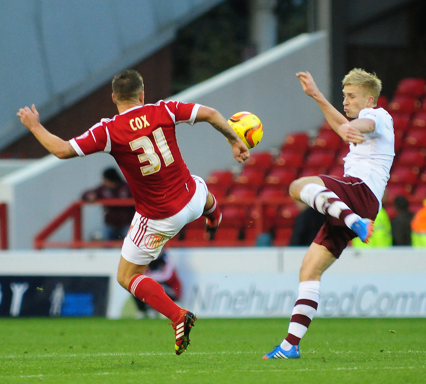 Burnley's Ben Mee vies for possession with Nottingham Forest's Simon Cox <br /> <br /> Photo by Chris Vaughan/CameraSport<br /> <br /> Football - The Football League Sky Bet Championship - Nottingham Forest v Burnley - Saturday 23rd November 2013 - The City Ground - Nottingham<br /> <br /> &copy; CameraSport - 43 Linden Ave. Countesthorpe. Leicester. England. LE8 5PG - Tel: +44 (0) 116 277 4147 - admin@camerasport.com - www.camerasport.com