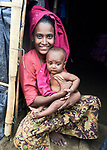 A Rohingya woman and her child sit in the doorway of their shelter in the sprawling Kutupalong Refugee Camp near Cox's Bazar, Bangladesh. More than 600,000 Rohingya refugees have fled government-sanctioned violence in Myanmar for safety in this and other camps in Bangladesh.