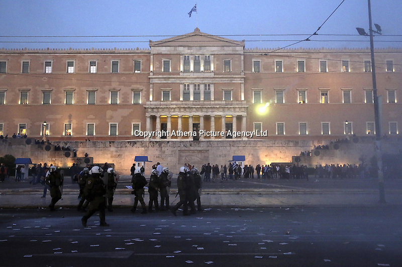 Pictured: Riot police in front of the Greek Parliament Sunday 09 May 2016<br />Re: Riots break out between protesters and police in Syntagma Square, while MPs in the Greek Parliament vote for new tax, pension and welfare reforms in Athens, Greece
