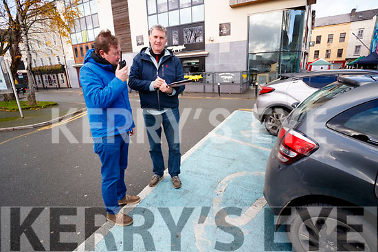 Pictured are Gardai from the Traffic Core, Castleisland, who are carrying out Operation Enable (which is checking to see if people are parking in disabled parking spaces in Tralee Town Centre), on Friday last, l-r: Garda Peter McCarthy and Sergeant Gearoid Keating.