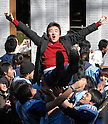 A successful candidate is lifted up by senior students at Tokyo University on Tuesday after Japan's most prestigious university announced 3,007 successful candidates out of 9,877 applicants. 10 March, 2009. (Taro Fujimoto/JapanToday/Nippon News)