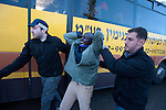 An African immigrant protestor is arrested in front of the Israeli parliament, the Knesset, in Jerusalem, Israel. Some 200 African asylum-seekers, who illegally entered Israel, demonstrated against their condition at a detention facility, from which they walked out of two days earlier. Israeli police and immigration arrested all protestors, and sent them back to Saharonim detention facility in the Negev desert.