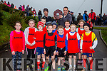 Kenmare Athletic Club were presented with the trophy for the Juvenile Cross Country Club of the Year for the 7th time in a row in Cahersiveen on Sunday, pictured front l-r; Abbie Dunlop, Anu Hayse,Jimmy Kelleher, Cillian Daly, Liam O'Sullivan, Kieran O'Donoghue, Neil O'Shea, Charlie Guest, Daragh Murphy, Mya Granville, Cathal Kelleher, back l-r; Dan O'Sullivan(County Cross Country Secretary), Conor Daly(Chairman Kenmare AC).