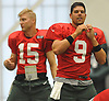 Bryce Petty #9, right, stretches alongside fellow quarterback Josh McCown #15 during New York Jets Training Camp at the Atlantic Health Jets Training Center in Florham Park, NJ on Monday, Aug. 7, 2017.