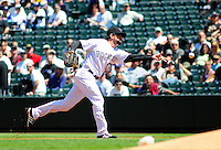 April 29, 2009: Rockies 1st baseman Todd Helton underhands a toss to 1st base for an out during a game between the San Diego Padres and the Colorado Rockies at Coors Field in Denver, Colorado. The Rockies beat the Padres 7-5.