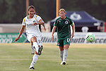 24 June 2009: Stephanie Cox (14) of the Los Angeles Sol takes a shot as Lori Chalupny (17) of Saint Louis Athletica looks on.  Saint Louis Athletica was defeated by the visiting Los Angeles Sol 1-2 in a regular season Women's Professional Soccer game at AB Soccer Park, in Fenton, MO.
