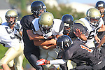 Beverly Hills, CA 09/23/11 - Rory Hubbard (Peninsula #33), Mathew Joncich (Peninsula #65) and unknown Beverly Hills player(s) in action during the Peninsula-Beverly Hills frosh football game at Beverly Hills High School.