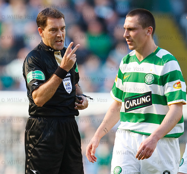 Referee Dougie McDonald speaks to Scott Brown