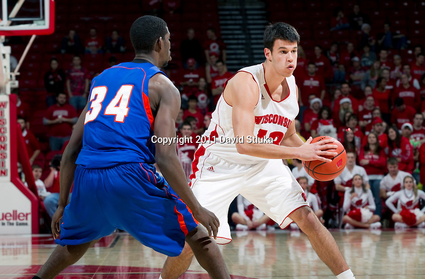 Wisconsin Badgers Duje Dukan (13) handles the ball during an NCAA college basketball game against the Savannah State Tigers on December 15, 2011 in Madison, Wisconsin. The Badgers won 66-33. (Photo by David Stluka)
