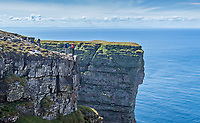 Dave Macleod and Andy Turner overlook steep cliffs of St John's Head, Isle of Hoy, Scotland