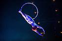 London, UK. 04.01.2014. Cirque du Soleil present QUIDAM at the Royal Albert Hall. Artists on the aerial hoops are Danila Bim, Lais Camila and Lisa Skinner. © Jane Hobson.