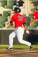 Micah Johnson (37) of the Kannapolis Intimidators follows through on his swing against the Rome Braves at CMC-Northeast Stadium on April 25, 2013 in Kannapolis, North Carolina.   (Brian Westerholt/Four Seam Images)