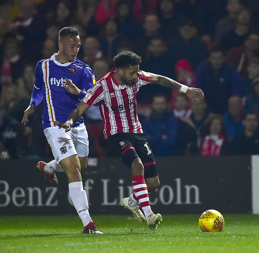 Lincoln City's Bruno Andrade appears to be tripped by Exeter City's Kane Wilson<br /> <br /> Photographer Andrew Vaughan/CameraSport<br /> <br /> The EFL Sky Bet League Two - Lincoln City v Exeter City - Tuesday 26th February 2019 - Sincil Bank - Lincoln<br /> <br /> World Copyright © 2019 CameraSport. All rights reserved. 43 Linden Ave. Countesthorpe. Leicester. England. LE8 5PG - Tel: +44 (0) 116 277 4147 - admin@camerasport.com - www.camerasport.com