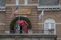 NWA Democrat-Gazette/J.T. WAMPLER A crew from The Lighting Master install a giant wreath on the front of the historic Washington County Courthouse Monday Nov. 5, 2018 as a brisk wind blows. The National Weather Service is calling for sunny skies today ((TUESDAY)) with temperatures in the high 60's.