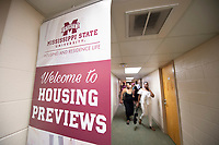 Incoming freshman and their parents tour the open show rooms of residence halls during their orientation sessions.<br /> (photo by Logan Kirkland / &copy; Mississippi State University)
