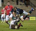 Deveronvale goalkeeper Darren McConnachie saves at the feet of Raith's Greig Spence  ...