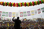 Ali Al-Hasan, a Syrian singer from Hassakah Syria, performs at Newroz, the Kurdish New Year celebration, in Viranşehir, Turkey, March 18, 2015. Al-Hasan is a refugee and has been living in Turkey for the past year. Newroz, or Nowruz, is an ancient holiday celebrated by a multitude of ethnic groups across Iran, Central Asia, and the Caucuses, and ushers in the first day of Spring, March 21. For Kurds, Newroz is a means of political and cultural expression, featuring Kurdish politicians, activists, and musicians, and has become a manifestation of Kurdish identity. In Turkey, the celebrations begin a few days before the Vernal Equinox, culminating in a huge gathering in the heart of Turkey's Kurdish population, the southeastern city of Diyarbakir. This year, PKK founder Abdullah Öcalan, who despite serving a life sentence for treason still enjoys widespread influence among Kurds, sent a letter that was read at Newroz in Diyarbakir, calling for an end to the PKK's armed struggle against the Turkish state.