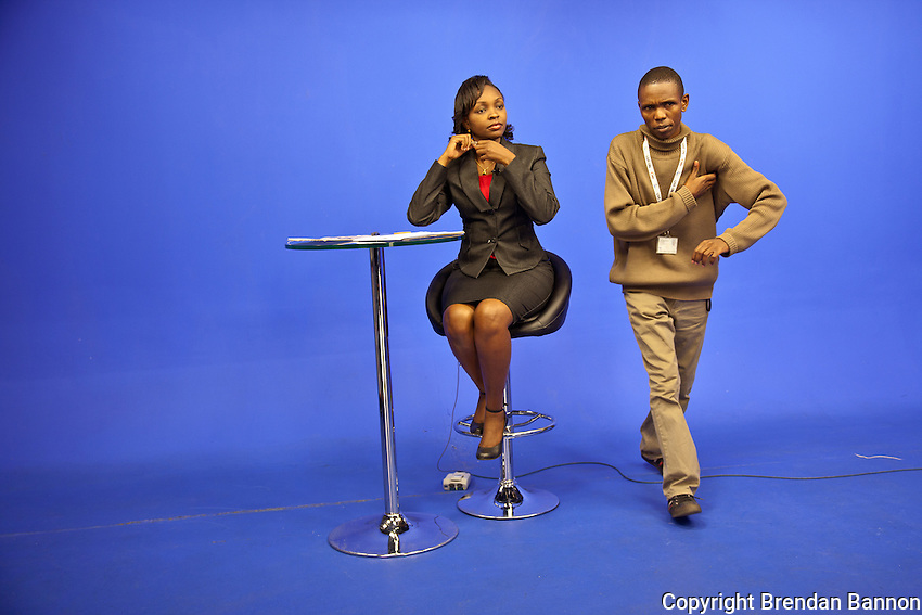 Peninah Karibe, news anchor, preparing for the 1 p.m. newscast at NTV on the day  senior Kenya's appeared at the International Criminal Court on charges.