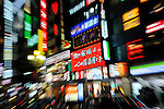 Zoom burst of Tokyo signs with Asian characters at night.