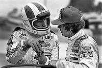 SEBRING, FL - MARCH 17: Rolf Stommelen of Germany (left) speaks with teammate Rick Mears of the United States during practice for the 12 Hours of Sebring IMSA GT race at Sebring International Raceway near Sebring, Florida, on March 17, 1979. (Photo by Bob Harmeyer)