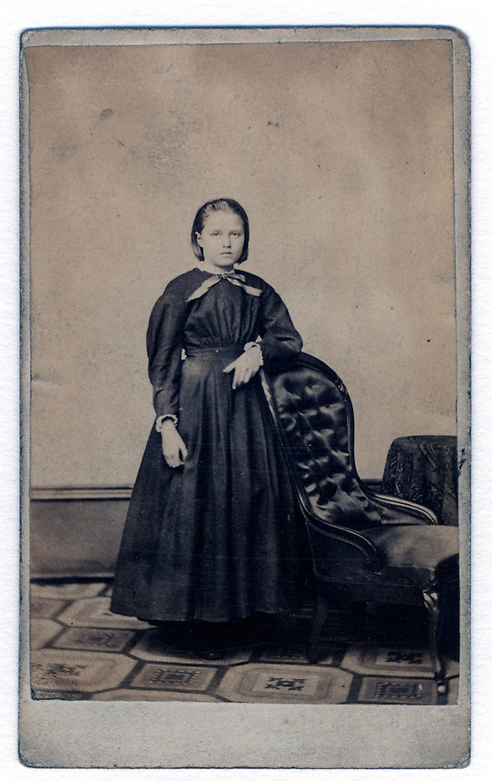 1a.<br /> <br /> 3 9/16  x  2 9/32  [sepia] 4  x  2 7/16  [card stock]<br /> <br /> young girl  [Sarah Voegtly]<br /> mounted on card stock<br /> <br /> verso<br /> CARGOS.<br /> PHOTOGRAPHIC GALLERIES,<br /> 69 Fifth St,. Pittsburgh,<br /> and<br /> 81 Federal St. Alleghent, Pa.<br /> in hand of Grace Steiner, top<br /> Sarah Voegtly