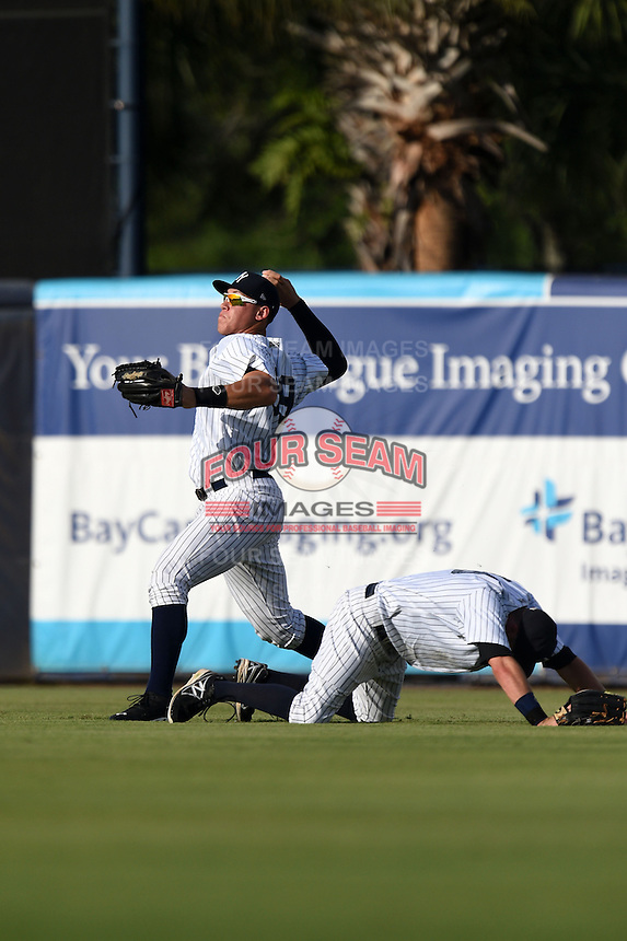 Tampa Yankees outfielder Aaron Judge (59) throws the ball in after a diving attempt by Jake Cave (18) during a game against the Dunedin Blue Jays on June 28, 2014 at George M. Steinbrenner Field in Tampa, Florida.  Tampa defeated Dunedin 5-2.  (Mike Janes/Four Seam Images)