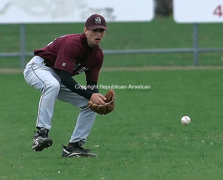 TORRINGTON, CT 4/25/07- 042507BZ07- Torrington's Tom Kasenetz (22) fields the ball against Wilby Wednesday.<br /> Jamison C. Bazinet Republican-American